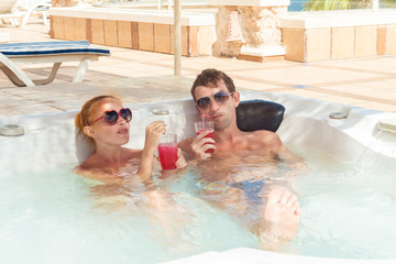 Young couple relaxing in pool
