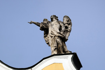 Angel on facade of Barmherzigenkirche in Graz, Austria