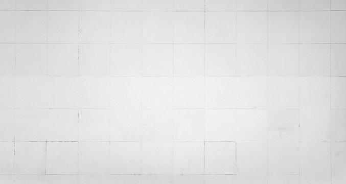 White wall with tiling. Background texture