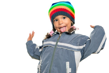 Small mixed race girl doing a funny gesture