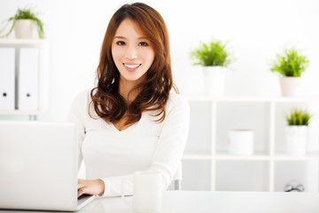 smiling Young asian woman  with laptop