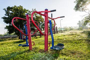 Exercise equipment in public park on sunrise.