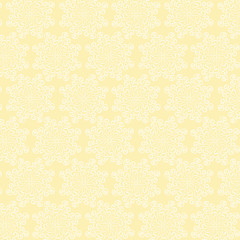 White circular floral pattern on yellow background