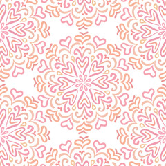 Elaborate circular ornament pattern in shades of pink