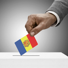 Black male holding flag. Voting concept - Andorra