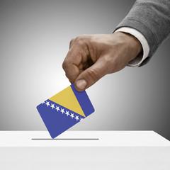 Black male holding flag. Voting concept - Bosnia and Herzegovina