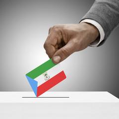 Black male holding flag. Voting concept - Equatorial Guinea