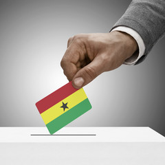 Black male holding flag. Voting concept - Ghana