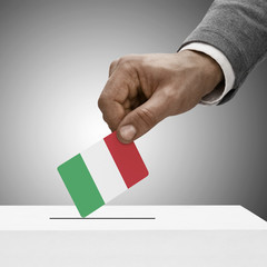 Black male holding flag. Voting concept - Italy