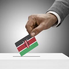 Black male holding flag. Voting concept - Kenya