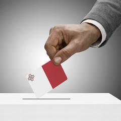 Black male holding flag. Voting concept - Malta