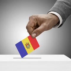 Black male holding flag. Voting concept - Moldova