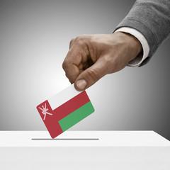 Black male holding flag. Voting concept - Oman