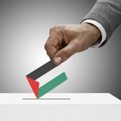 Black male holding flag. Voting concept - Palestine