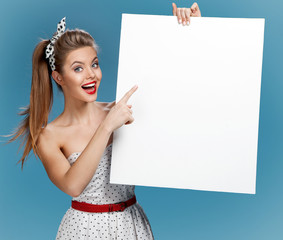 Pinup woman shows forefinger hand on the blank banner
