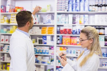 Pharmacist looking a medication for a prescription