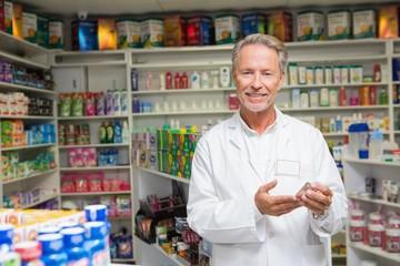 Senior pharmacist holding medicine