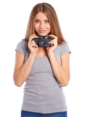Pretty girl with old camera