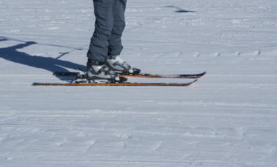 skis feet foot snow