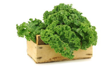 kale cabbage in a wooden crate on a white background