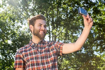 Handsome hipster taking a selfie