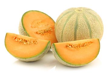 fresh cantaloupe melon and a cut one on a white background