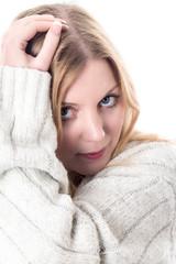 Model Released. Happy Young Woman Wearing a Woolen Jumper