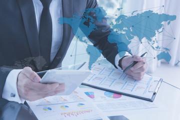 businessman using tablet, business globalization concept