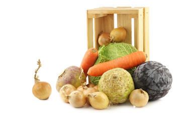 collection of many fresh winter vegetables in a wooden crate on