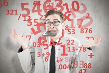 Composite image of geeky shrugging businessman biting calculator