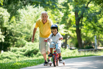 grandfather and child have fun  in park