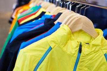 Sportswear on hangers in store