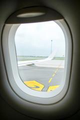 Looking through airplane window