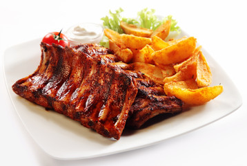 Foto auf Acrylglas Grill / Barbecue Grilled Pork Rib and Fried Potatoes on Plate
