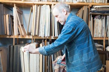 An artist prepares canvas