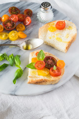 Bruschetta with a Mix of Red, Orange and Yellow Cherry Tomatoes