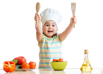 Smiling little cook with ladle, isolated on white