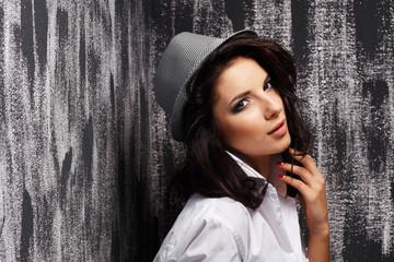 Portrait attractive woman  on grunge background.