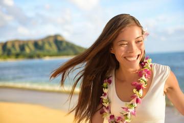 Hawaii beach woman happy on Hawaiian holidays