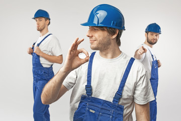 Three handsome guys as workers