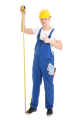 career concept - man builder in blue uniform holding measure tap