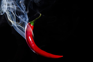 In de dag Hot chili peppers Smoking red hot chili pepper on black background