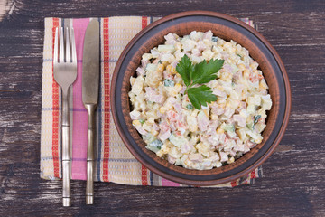 Russian traditional salad olivier with pea