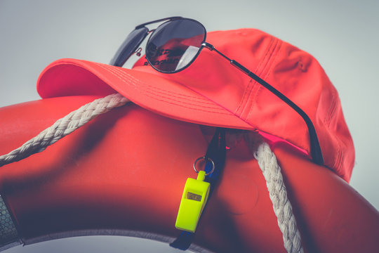 Hat glasses whistle and lifesaver Lifeguard equipment Summer safety concept
