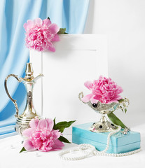 Still life with pink peonies, antique silver tableware