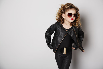 Cool girl in leather jacket with attitude
