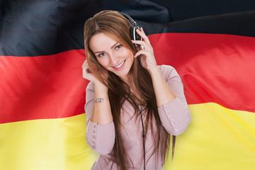 Woman Listening German Learning Audiobook