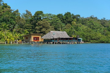 Tropical restaurant and cabin over water in Panama