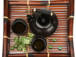 Tea set on a bamboo mat
