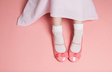 Young girl pastel pink outfit from above
